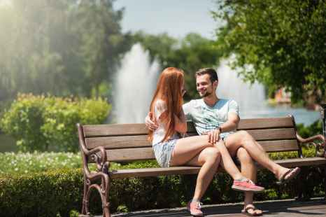man and woman sitting on a bench